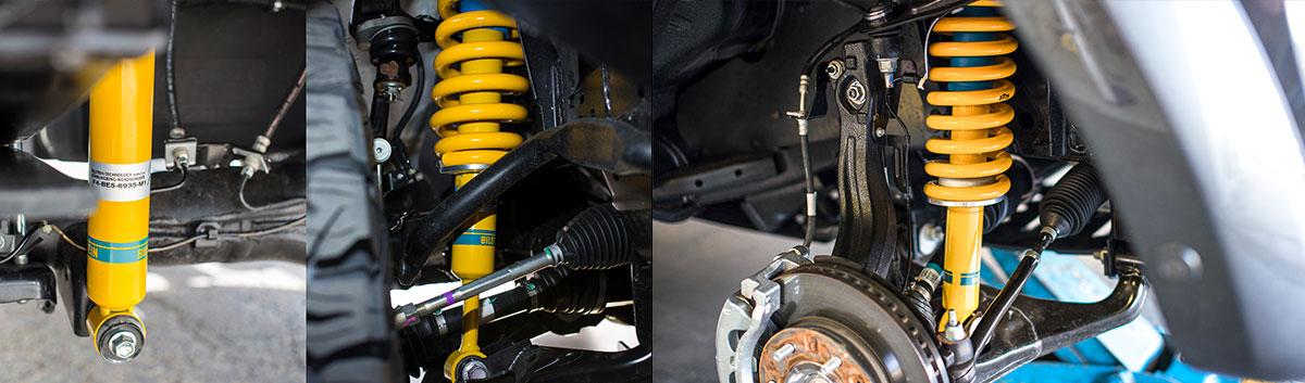 Close up of a series of Bilstein shock absorbers installed for 4WD.